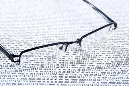 Eyeglasses on binary code Stock Photo - 13752633
