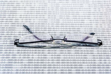 Eyeglasses on binary code Stock Photo - 13752652
