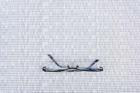 Eyeglasses on binary code Stock Photo - 13752653