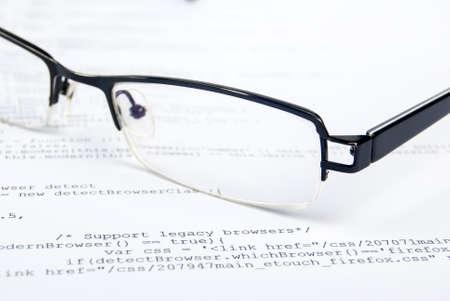Eyeglasses on html page Stock Photo - 13751836