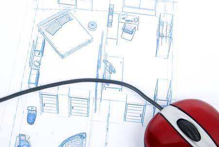 Computer mouse on blueprint photo