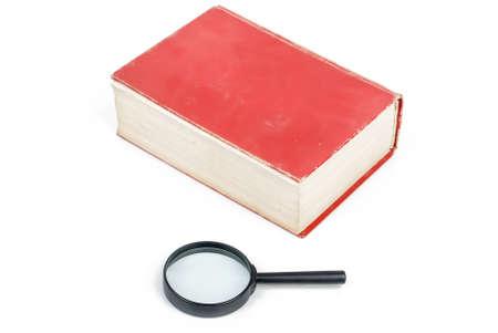 Lupa con el libro Foto de archivo - 13763209