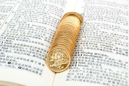 Coins with book photo