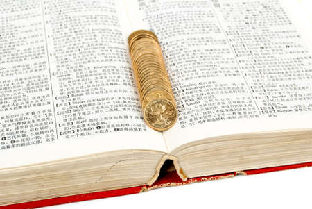 Coins with book Stock Photo - 13764390