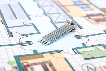 constrution: Nails on blueprint