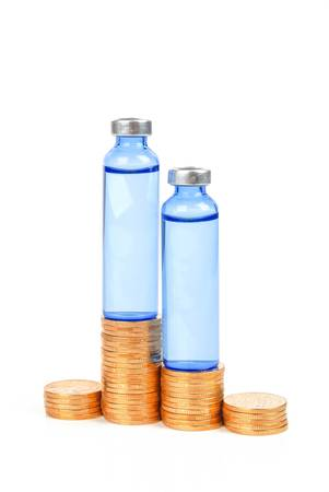 Coin and vial Stock Photo - 13781902