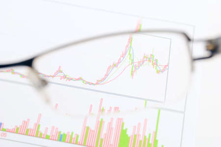 Glasses on stock graph Stock Photo - 13811725