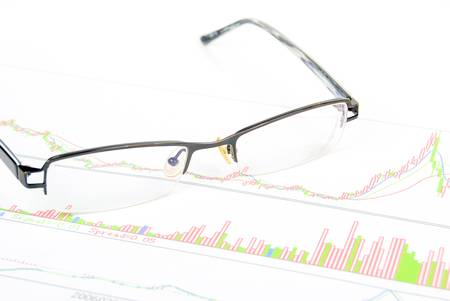 Glasses on stock graph Stock Photo - 13811568
