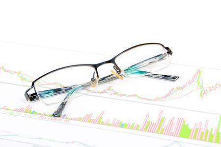 Glasses on stock graph photo