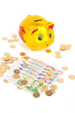 Chinese currency with piggy bank Stock Photo - 13832556