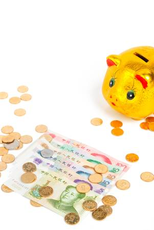 coins shot in golden color: Chinese currency with piggy bank Stock Photo