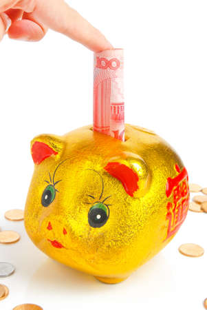 coins shot in golden color: Piggy bank Stock Photo