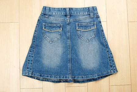 jeanswear: Jeans skirt on floor Stock Photo