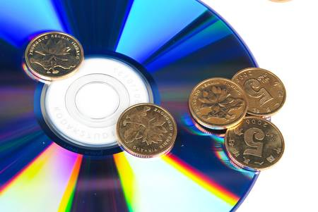 DVD with coin Stock Photo - 13997656