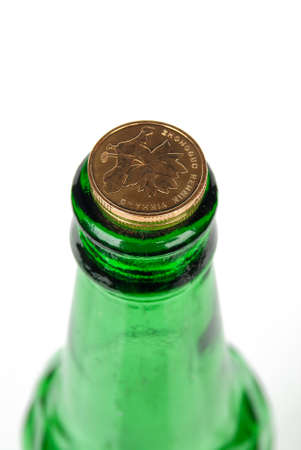 Beer bottle and coin photo