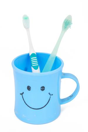Toothbrush in a cup photo