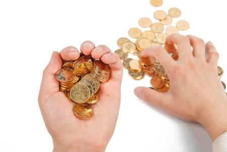 avid: Greedy hand grabbing gold coin Stock Photo