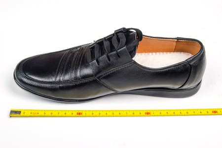 Shoe and ruler Stock Photo - 14401519