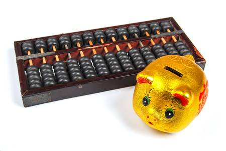 economic revival: Abacus and pig bank