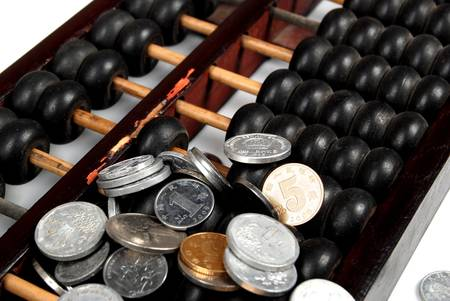 economic revival: Abacus and coins Stock Photo