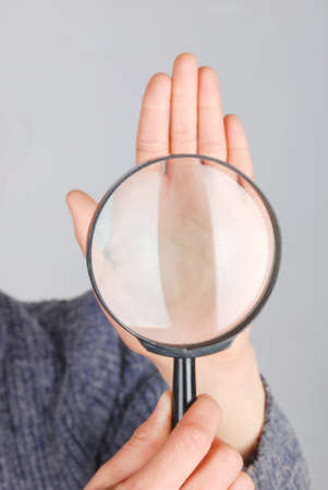 Magnifier and hand photo