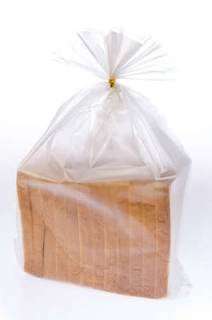 Bread in the plastic bag isolated on white background photo