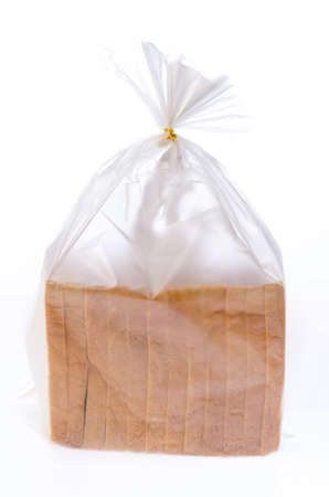 Bread in the plastic bag isolated on white background