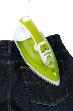 Ironing tool and jeans photo