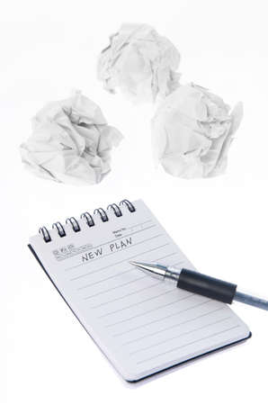 Crumpled paper ball and notepad photo