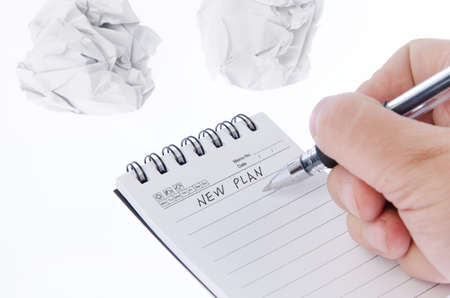 Crumpled paper ball and notepad Stock Photo - 17351636