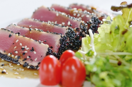 a Raw fish tuna with salad frieze photo