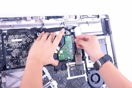 a man repair imac computer change harddisk Stock Photo