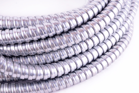 conduit: a steel flexible conduit use for building work