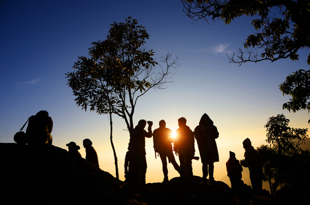 Group of people on top of a mountain in the chan rai thailand photo