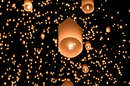 Launching rice paper hot air balloons during the Loi Krathong festival in Chiang Mai, Thailand.