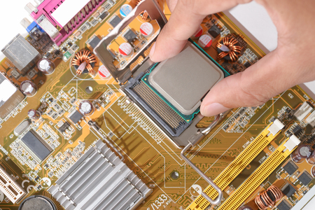 intel: technicial install cpu chip  to mainboard computer Stock Photo