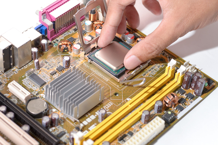 mainboard: technicial install cpu chip  to mainboard computer Stock Photo