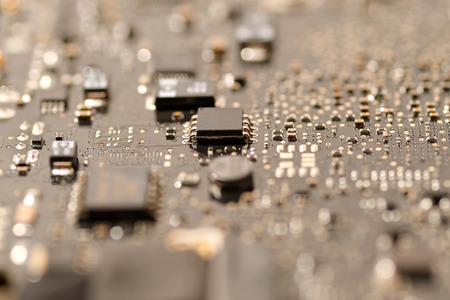 close up ic surface mount device on mainboard circuit