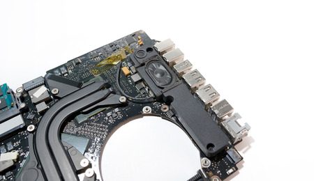 audio book: close up inside laptop computer motherboard and speaker