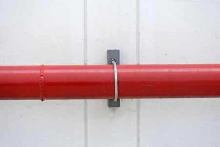 extinguishing: red pipeline extinguishing water in industrial building