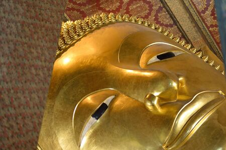 recline: Reclining Buddha gold statue. Wat Pho, Bangkok, Thailand Stock Photo