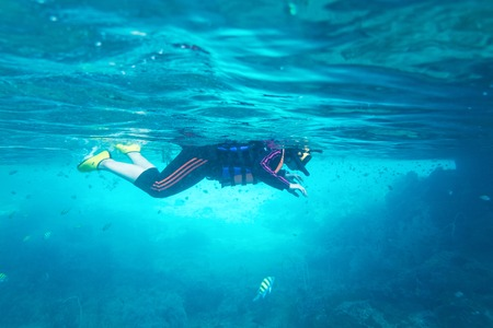 girl snorkeling mask under water from thailand Stock Photo