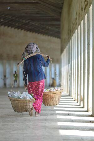 Woman sell Fruit walking in temple from Myanmar