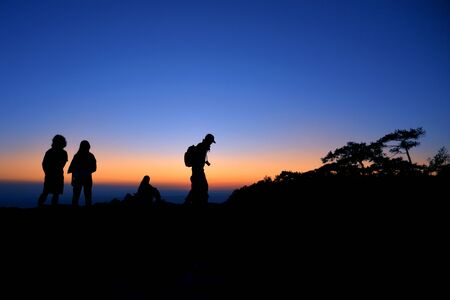The silhouette of tourist in the mountains