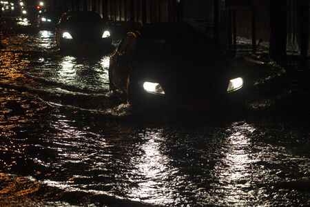 Flooded roads in Bangkok at night aftre raining