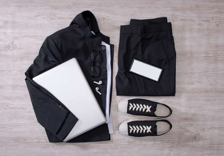 Clothes trousers and shoes on the floor