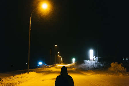 Road in village with streetlights and snow