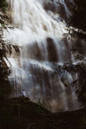 Waterfall falling dawn on rocks in forest