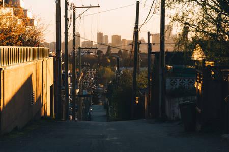 City street illuminated by sunset