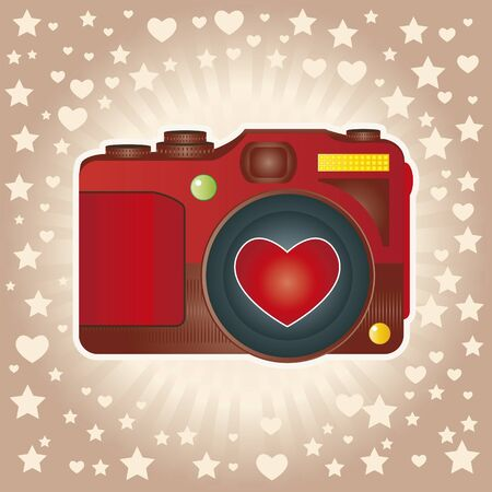Red camera with lens heart-shaped.